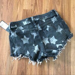 Hi rise stretch black denim shorts with stars